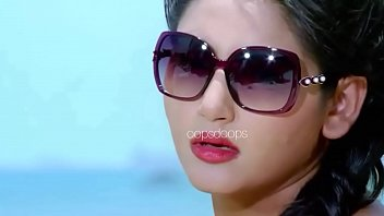 ragini dwivedi crimson sundress flying from wind displaying a