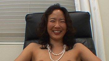 Asian girl licking cock