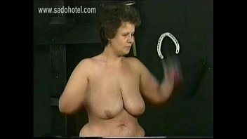Old german dirty slave with big ass and large tits got hit with a whip on her back in a dungeon