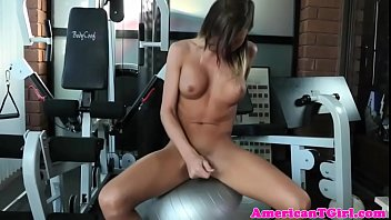 Busty transwoman tugs cock after working out