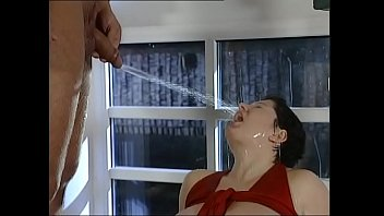 Shower of piss on a brunette with big tits