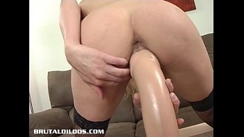 Busty blonde bounces up and down on a big brutal dildo