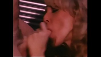 Blonde Randi Storm with great tits sucks dick behind the bar