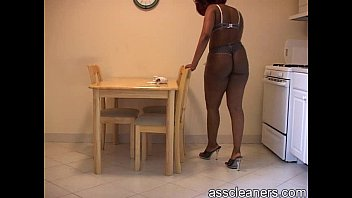 Chubby ebony mistress in bikini cleans the table in a sexy way