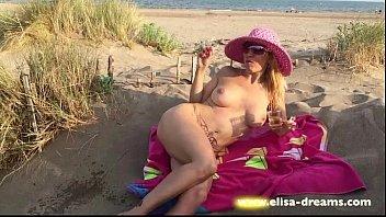 flashing nude in a insane beach