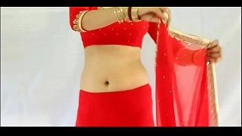 cool gal dressed in crimson saree and displaying.