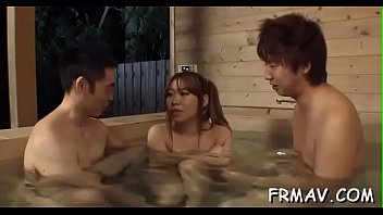 Cute japanese merely gives superb blowjob during trio