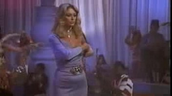 coerced blond damsel doing a striptease