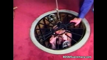 BDSM action wiht slut pussy is clamped