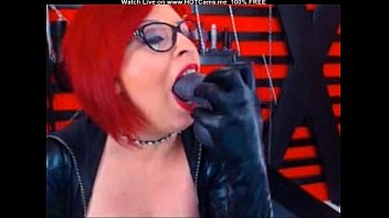 Mature Redhead With Glasses Sucking Fake Cock