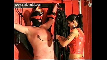 Horny mistress ties up slave in her own dungeon and put clamps and weights on his nipples