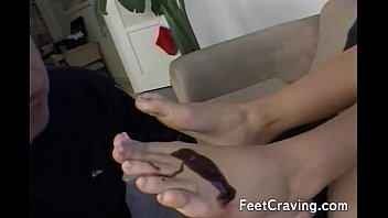Hottie getting her feet and toes licked