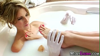 Milk bathing lesbian ass