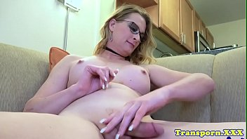 Busty spex transsexual tugging her cock solo