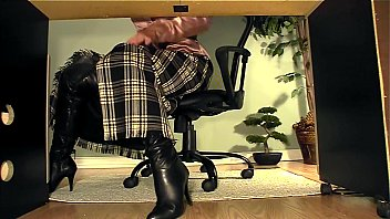 assistant with footwear under desk onanism.
