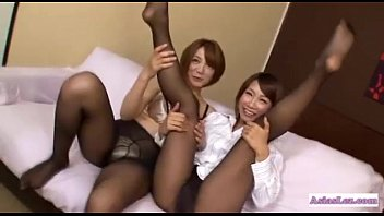japanese doll in stockings rubbin' other lady hooters.