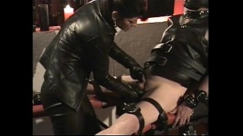 dominatrix with ginormous udders burns nads of roped marionette