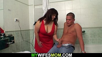 Big boobs mother-in-law helps him cum